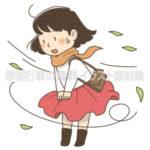 強い風にスカートを抑える女性のイラスト(カラー版)